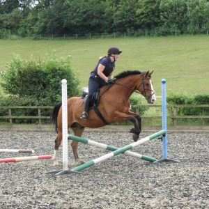 Lisa Bluett Jumping on Burt